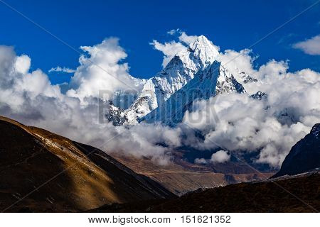 Himalaya Inspirational Landscape Ama Dablam Mountain in Nepal. Beautiful View on Mountain Peak in Himalayas over Blue Sky.