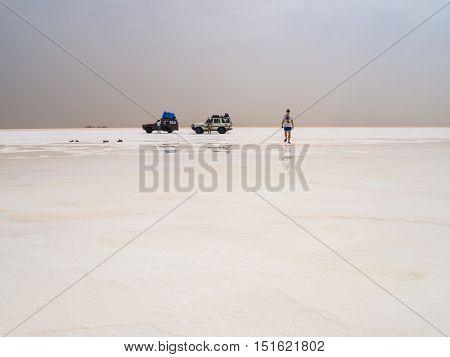 AFAR REGION ETHIOPIA - JUNE 26 2016: Tourists visiting salt desert and lake in the Afar Region Danakil Depression Ethiopia.