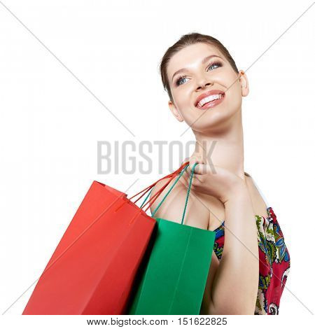 Shopping woman holding shopping bags. Beautiful young female shopper smiling happy, isolated on white.