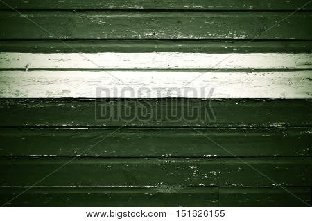 old wooden boards dark green color texture and background and white strip