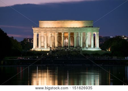 The Lincoln Memorial and the Reflecting Pool in Washington D.C. illuminated at sunset