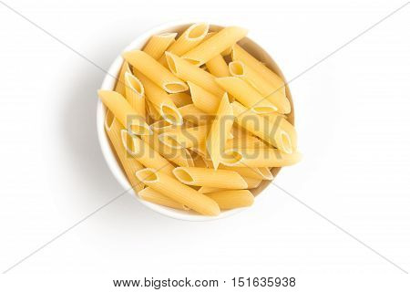 Penne into a bowl isolated on white background