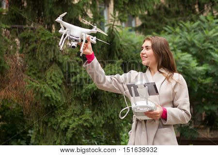 Young Woman Holding Radio Controller With Tablet And Launches Th