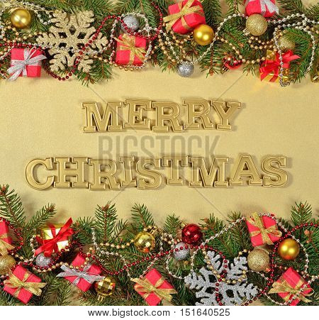 Merry Christmas Golden Text And Spruce Branch And Christmas Decorations