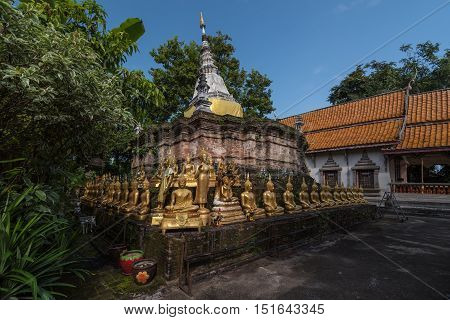 CHIANG RAI THAILAND - OCTOBER 132016 - Pagoda tilt in Wat Phra Chao Lan Thong is located within the city walls of Chiang Saen and was built by Prince Thong Ngua a son of King Tilokkarat.