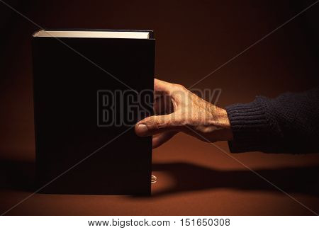 One Thick Book In A Hand