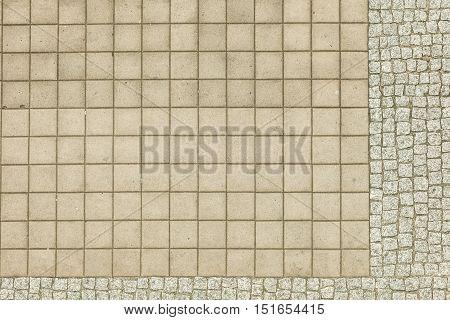 City urban civil engineering road communication concept. Fragment of pavement. Concrete cobblestone sidewalk pattern.