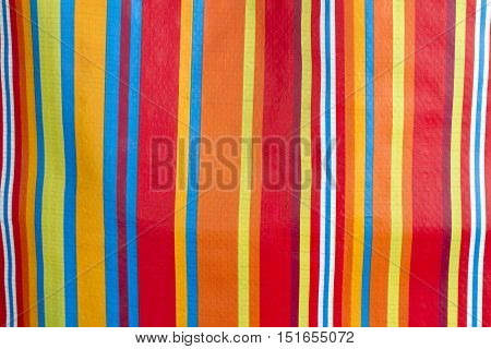 Colorful stripes in detail as background. Shot in Studio.