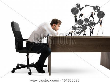 Businessman watches a teamwork of businesspeople work together to a system of gears