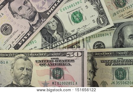 Background with money american dollars of different nominal top view close up