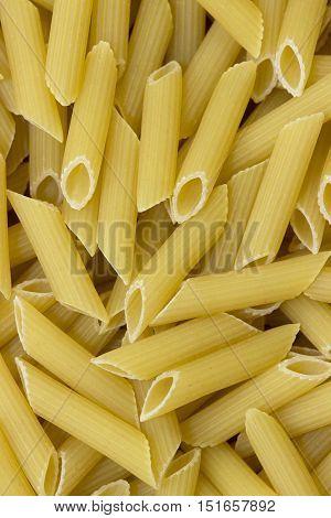 Penne pasta background closeup top view macro