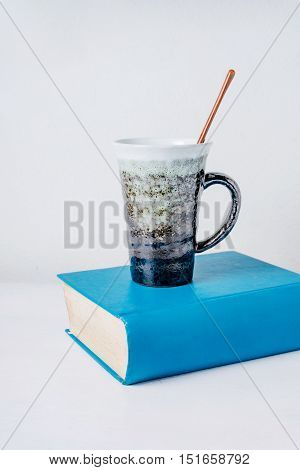 Cup of coffee or cup chocolate on book