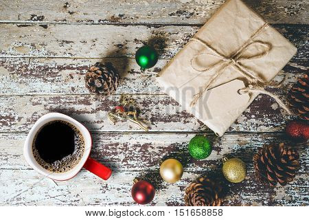 Christmas gift boxes and cup coffee on wooden table. Top view.