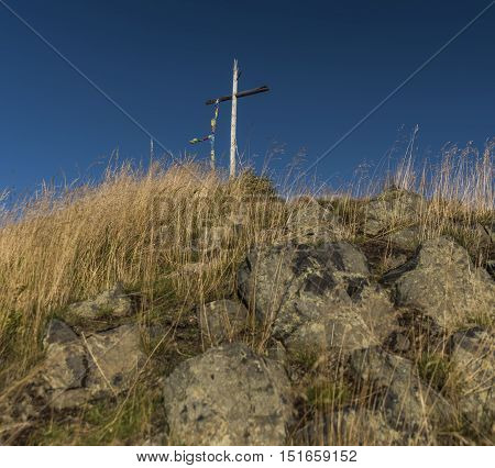 Cross on Velky Spicak hill in mountains