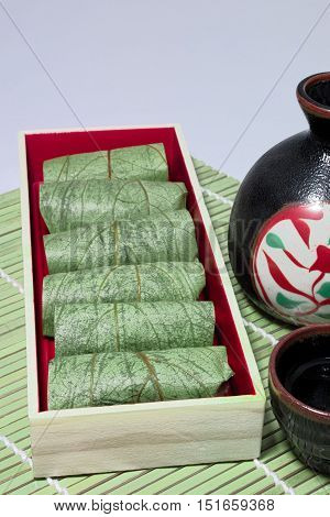 Hot sake and persimmon leaf of sushi