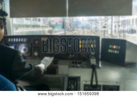 abstract Train Conductor in blurred background .