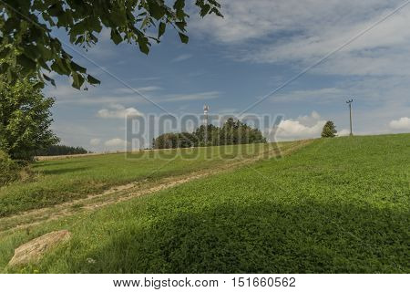 Summer evening near Roprachtice village with green meadow