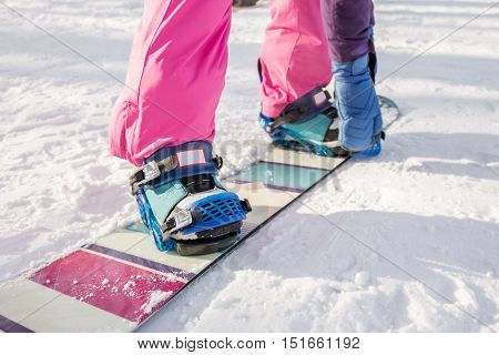 The Girl In Pink Pants Buttons Fastening Snowboard