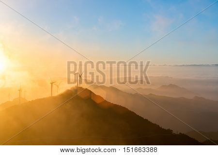 wind turbines at sunrise on the top of jiugong mountain hubei provinceChina