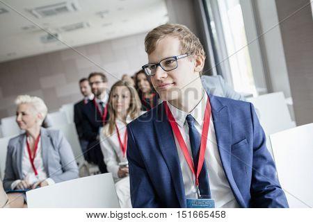 Businessman attending seminar in convention center