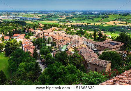 Agricultural Landscape With Old Village In Toscana