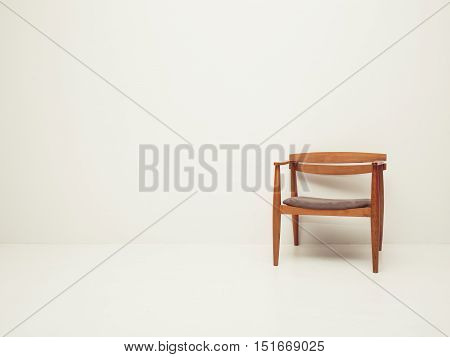 vintage tone of White wall texture with a chair