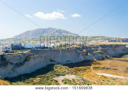 Santorini island in Greece landscape steep cliffs dirt roads and vegetation burned