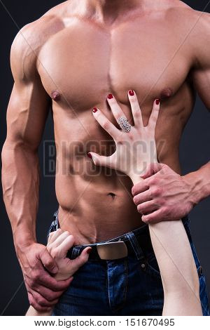Sex Concept - Female Hands Touching Muscular Man Over Grey