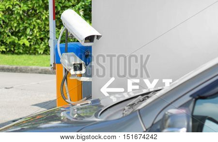 Security equipment concept - CCTV camera surveillance on car parking with space for text