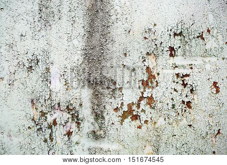 Abstract grunge peeling paint texture. Old weathered background. Peeling paint with cracks and rust spots.