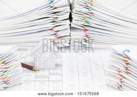 House And Pencil Have Blur Document As Foreground And Background