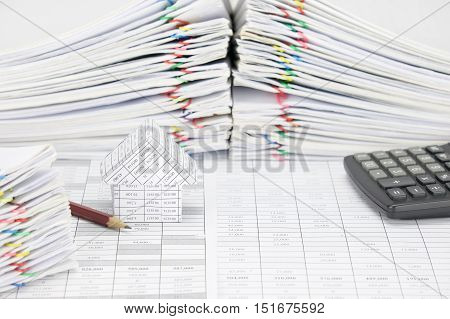 House And Pencil Have Blur Pile Overload Document And Calculator