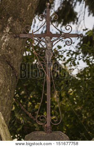 old rusty crucifix with Jesus Christ, almost rolling