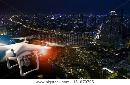 aerial view of using drone to take a photography of skyscraper at night