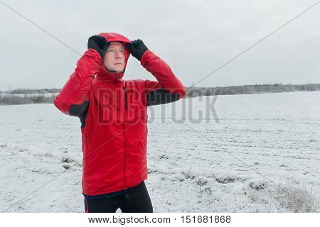 Portrait of sportsman during his winter running training session outdoors