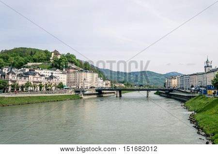 Salzburg Austria - April 29 2015: Salzach river. Salzburg is renowned for its baroque architecture and was the birthplace of Mozart. It is an Unesco World Heritage Site.