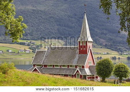 Traditional norwegian red stave church. Rodven. Travel Norway. Horizontal