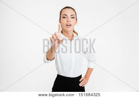 Young beautiful businesswoman pointing at camera isolated on the white background