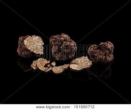 Black truffles mushroom on a black background