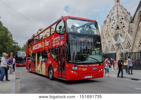 Barcelona, Spain - 24 September 2016: Hop On Hop Off tourist bus at Barcelona. Double Decker open air sightseeing coach bus before Sagrada Familia.