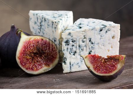blue cheese on a wooden board