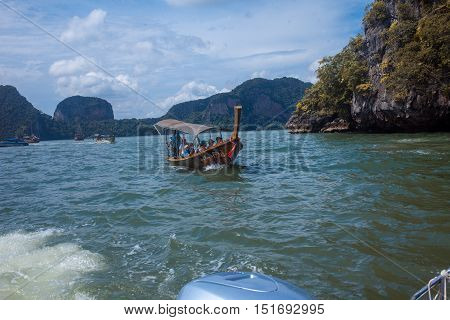 PHUKET, THAILAND, on 11 NOVEMBER, Long boat and rocks in the Gulf of Thailand the island of Phuket on November 11, 2014