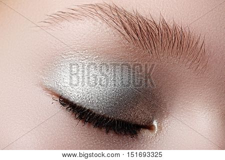 Closed Eyes Of Young Woman With Shining Sparkle Makeup. Closeup