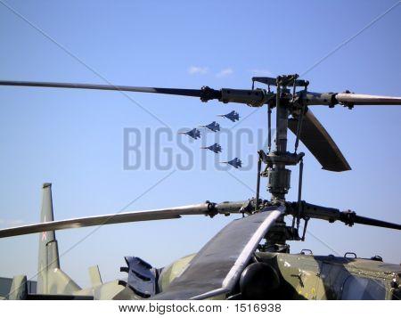 Warplanes Between The Blades Of Helicopter
