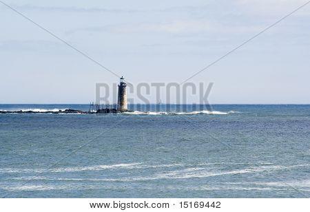 Maine Lighthouse And Coastal Scene
