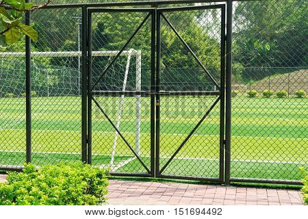 soccer field being locked with padlock in outdoor
