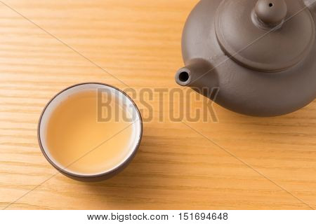 top view cup of tea and teapot on wood table