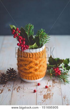 Christmas arrangement of holly berries