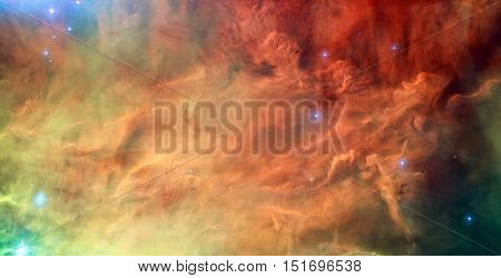 Waves breaking in the stellar Lagoon Nebula, Messier 8. It is a giant interstellar cloud in the constellation Sagittarius. Retouched image. Elements of this image furnished by NASA.