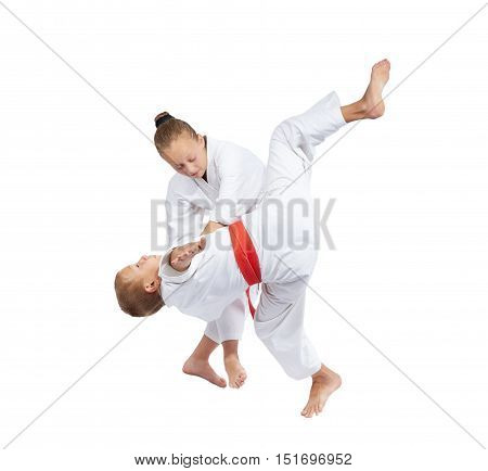 Children make the throws of judo in judogi